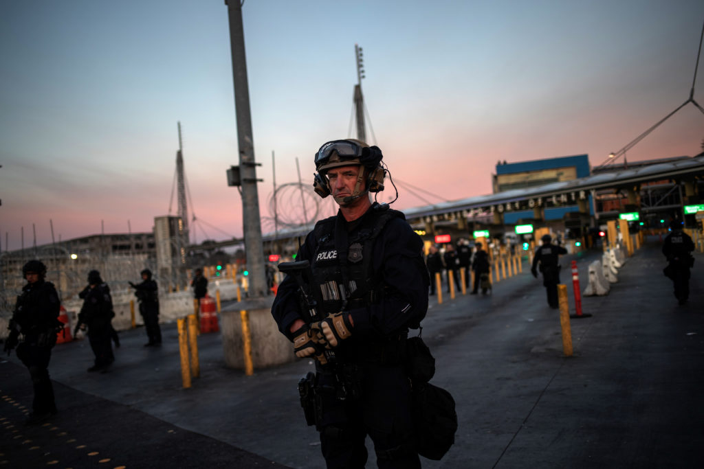 U.S. Customs and Border Protection (CBP) Special Response Team (SRT) officers stand guard at the San Ysidro Port of Entry after the land border crossing was temporarily closed to traffic from Tijuana, Mexico November 19, 2018. REUTERS/Adrees Latif