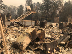 A set of stairs sit amongst ruins after wildfires devastated the area in Paradise, California, U.S., November 12, 2018. Picture taken November 12, 2018. REUTERS/Sharon Bernstein