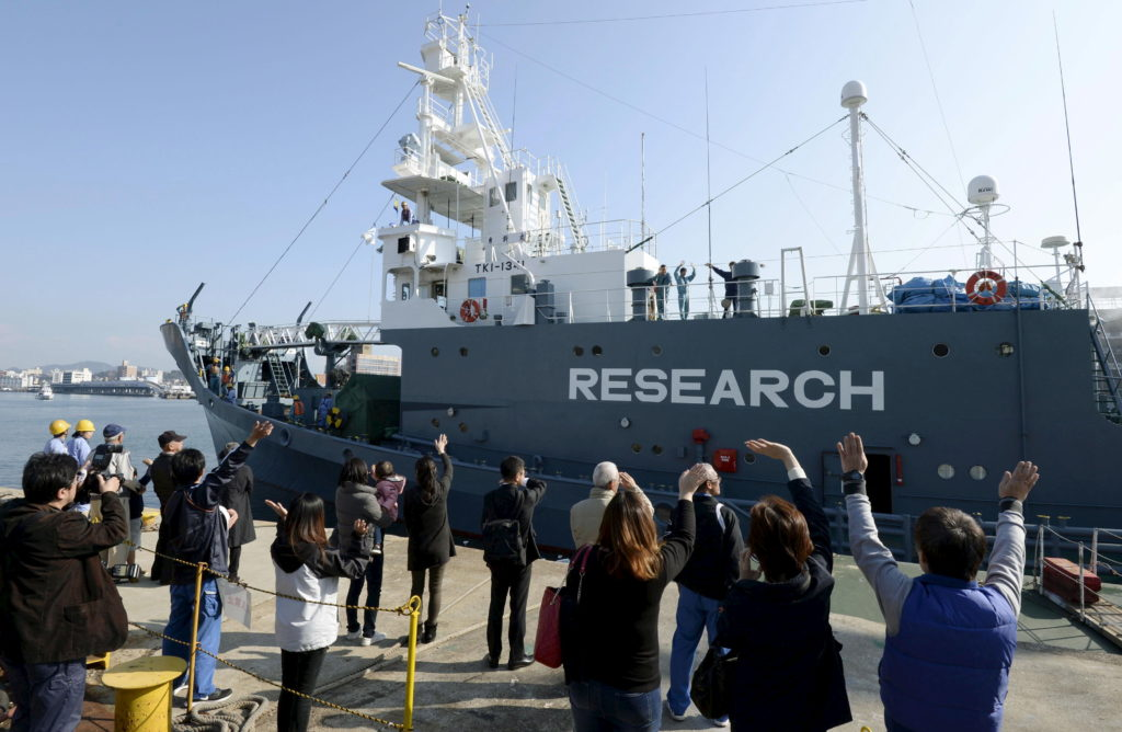 Families of crew members wave as Japanese whaling vessel Yushin Maru leaves for the Antarctic Ocean at a port in Shimonoseki, southwestern Japan, in this photo taken by Kyodo in December 2015. Photo by Kyodo via Reuters