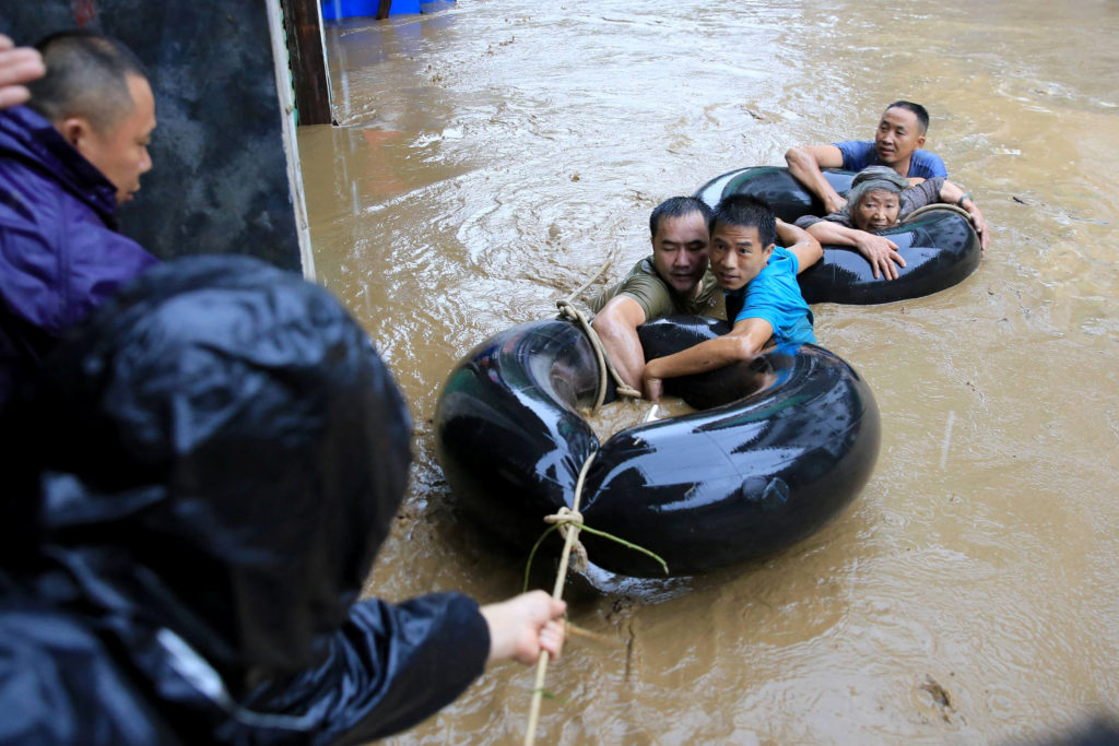 Rescuers evacuate people in a flooded area in Rongshui Miao Autonom…