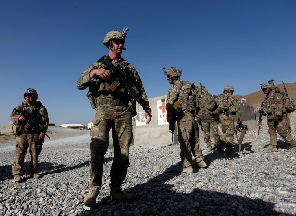 U.S. troops wait for their helicopter flight at an Afghan National Army (ANA) base in Logar province, Afghanistan. Photo b...