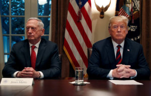 President Donald Trump speaks to the news media while gathering for an October briefing from his senior military leaders, including Defense Secretary James Mattis (L), in the Cabinet Room at the White House in Washington, D.C. Photo by Leah Millis/Reuters
