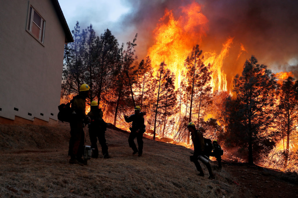 A group of U.S. Forest Service firefighters monitor a back fire while battling to save homes at the Camp Fire in Paradise, California on November 8, 2018. Photo by Stephen Lam/Reuters