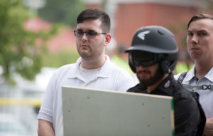 "FILE PHOTO: James Alex Fields Jr., (L) is seen attending the ""Unite the Right"" rally in Emancipation Park before being arrested by police and charged with one count of second degree murder, three counts of malicious wounding and one count of failing to stop at an accident that resulted in a death after police say he drove a car into a crowd of counter-protesters later in the afternoon in Charlottesville, Virginia, U.S., August 12, 2017. Photo by Eze Amos/File Photo/Reuters"