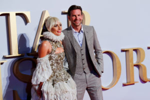 """FILE PHOTO: Cast member Lady Gaga and director Bradley Cooper attend the UK premiere of """"A Star is Born"""" in London, Britain, September 27, 2018. Photo by Eddie Keogh/Reuters/File Photo"""