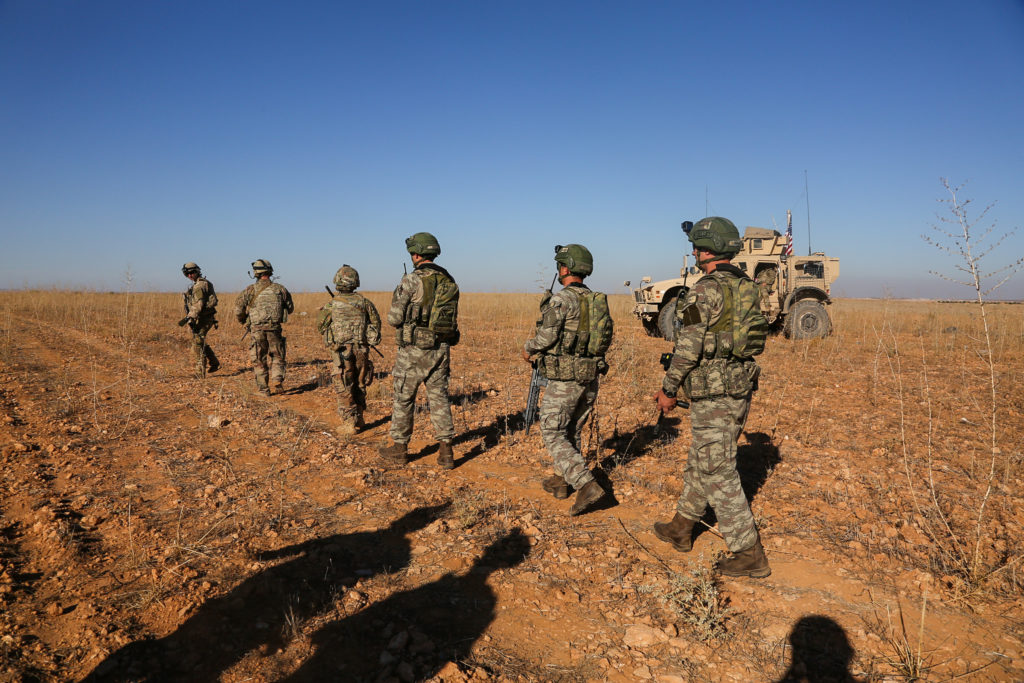 U.S. and Turkish soldiers conduct the first-ever combined joint patrol outside Manbij, Syria. Photo courtesy of Arnada Jon...