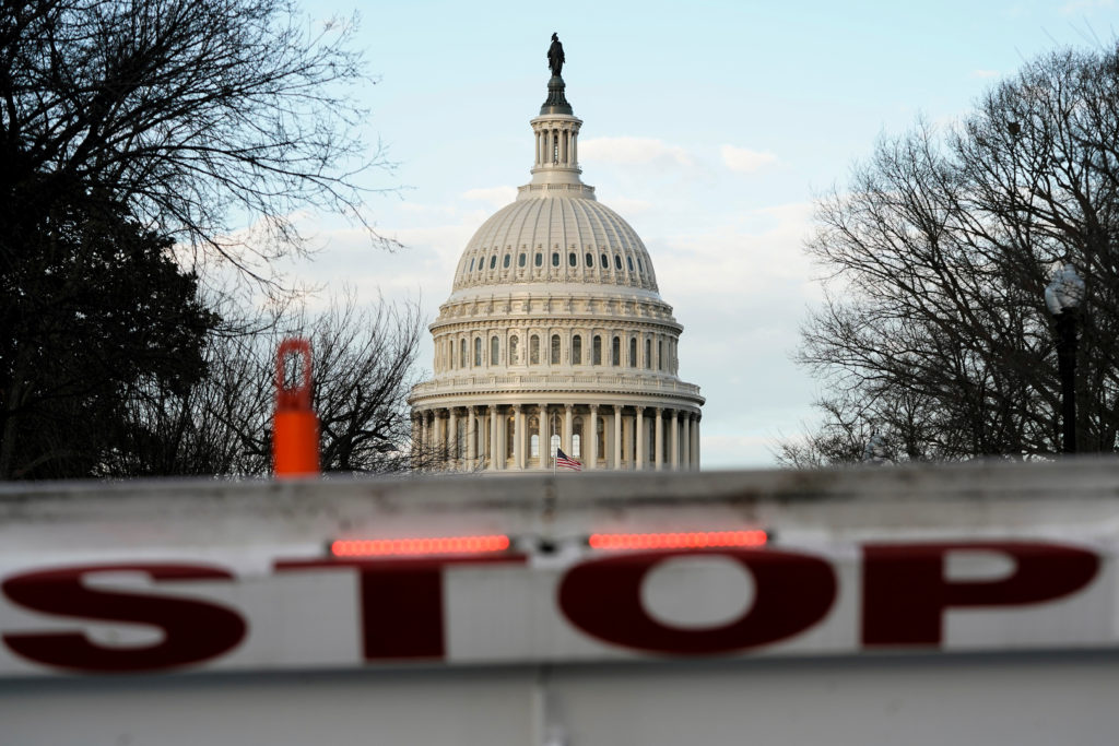 A security barricade is placed in front of the U.S. Capitol on the first day of a partial federal government shutdown in W...