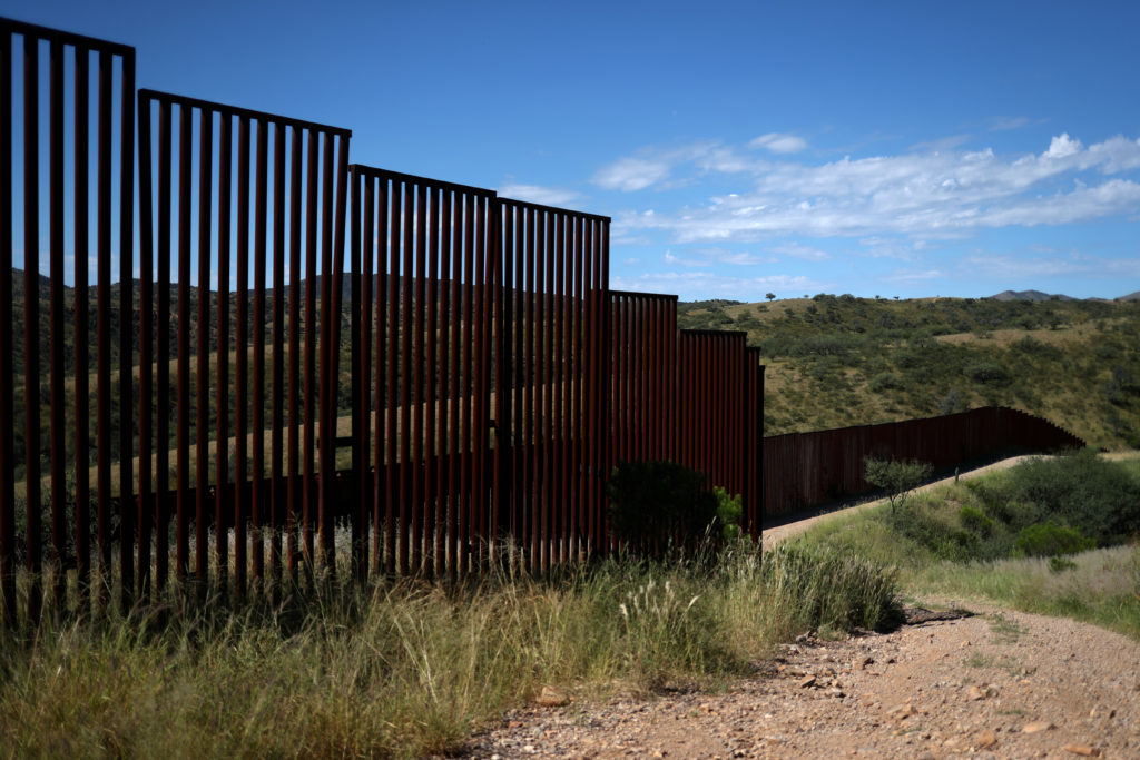 Different generations of the U.S. border wall with Mexico are seen from the United States in Nogales, Arizona, on Sept. 13, 2018. REUTERS/Adrees Latif/File Photo