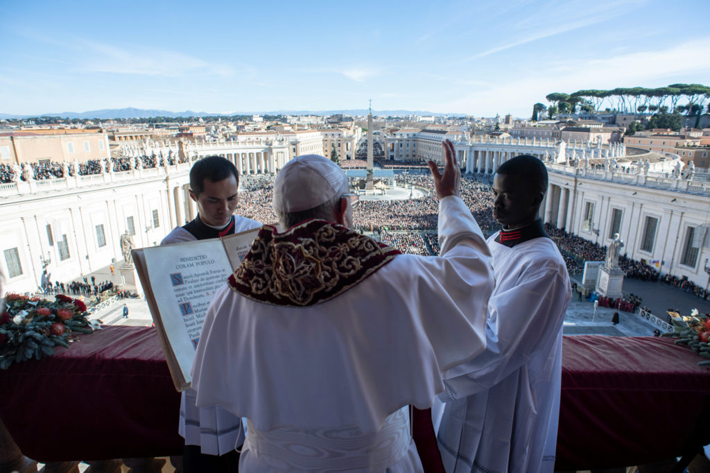 """Pope Francis delivers the """"Urbi et Orbi"""" message from the main balcony of Saint Peter's Basilica at the Vatican. Photo by ..."""