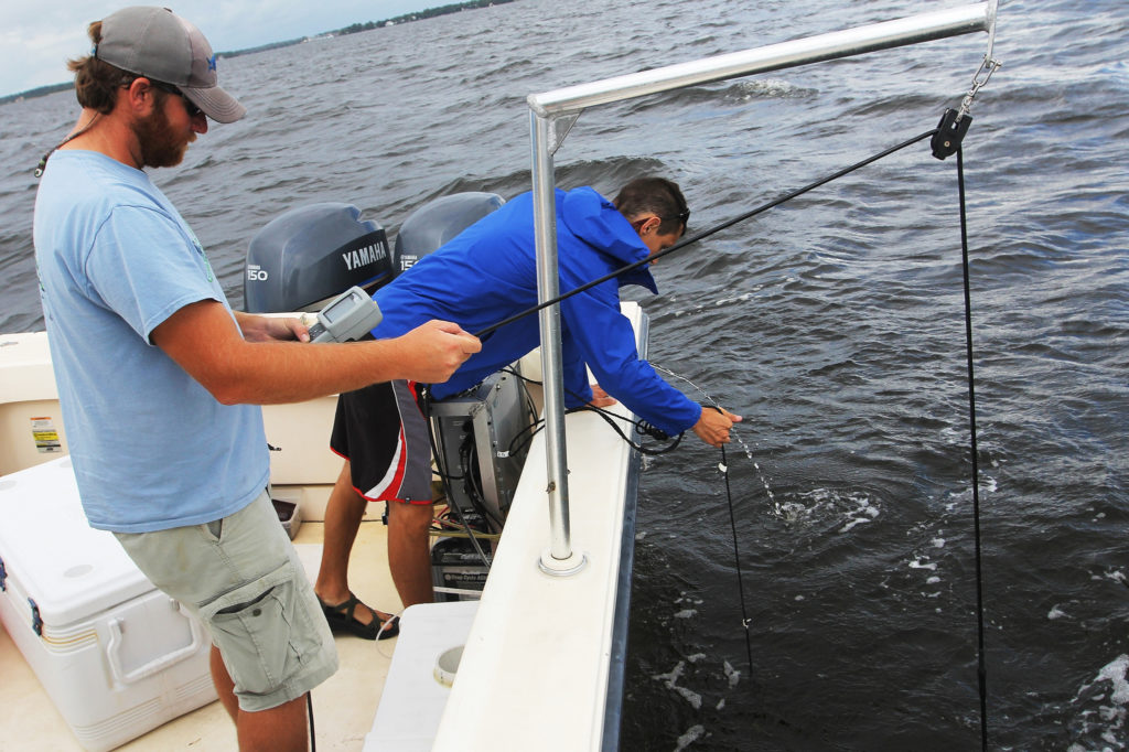 Hans Paerl heads up the Neuse River Estuary Modeling and Monitoring Program, ModMon, and a ferry-based water quality monitoring program, FerryMon. The projects use environmental sensors and microbial surveys to keep tabs on water quality. Photo by UNC Research