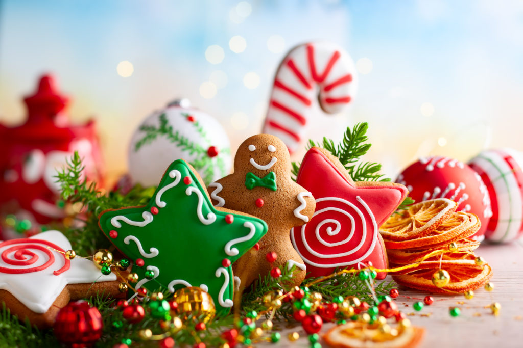 Festive concept with Christmas gingerbread cookies, fir branches and winter spices. (Photo by sarsmis/via Adobe Stock images).