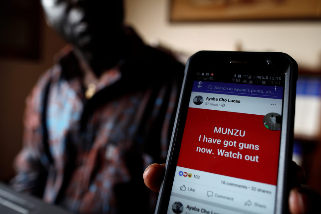 Simon Munzu, a former UN official, who is campaigning for peace in the Anglophone regions of Cameroon, shows a threat message posted against him on social media by separatists during an interview with Reuters in Yaounde, Cameroon October 3, 2018. Picture taken October 3, 2018. Photo by REUTERS/Zohra Bensemra