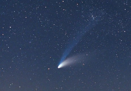 Comet Hale-Bopp has a blue ion tail as well as a curved dust tail. Photo by Astronomy For Beginners, Andy Roberts, CC BY 4.0