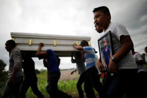 Friends and family carry a coffin with the remains of Jakelin Caal, a 7-year-old girl who handed herself in to U.S. border agents earlier this month and died after developing a high fever while in the custody of U.S. Customs and Border Protection, during her funeral at her home village of San Antonio Secortez, in Guatemala December 25, 2018. Photo by Carlos Barria/Reuters