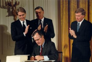 EPA Administrator William Reilly watches as President George H.W. Bush signs the Clean Air Act Amendments. Source: EPA