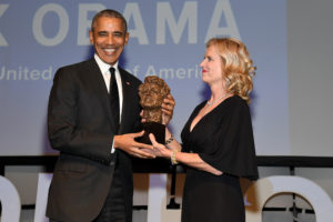 Former President Barack Obama accepts an award onstage from Robert F. Kennedy Human Rights President Kerry Kennedy during the 2019 Robert F. Kennedy Human Rights Ripple Of Hope Awards in New York City. Photo by Kevin Mazur/Getty Images for Robert F. Kennedy Human Rights