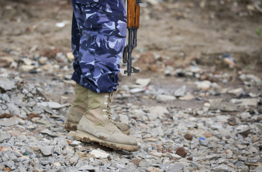 Baidoa, Somalia - May 01: Close-up of a former militia fighter with a gun in the rehabilitation center for former Al-Shaba...