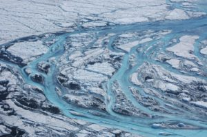 Large rivers form on the surface of Greenland each summer, rapidly moving meltwater from the ice sheet to the ocean. Image and caption by Sarah Das/Woods Hole Oceanographic Institution