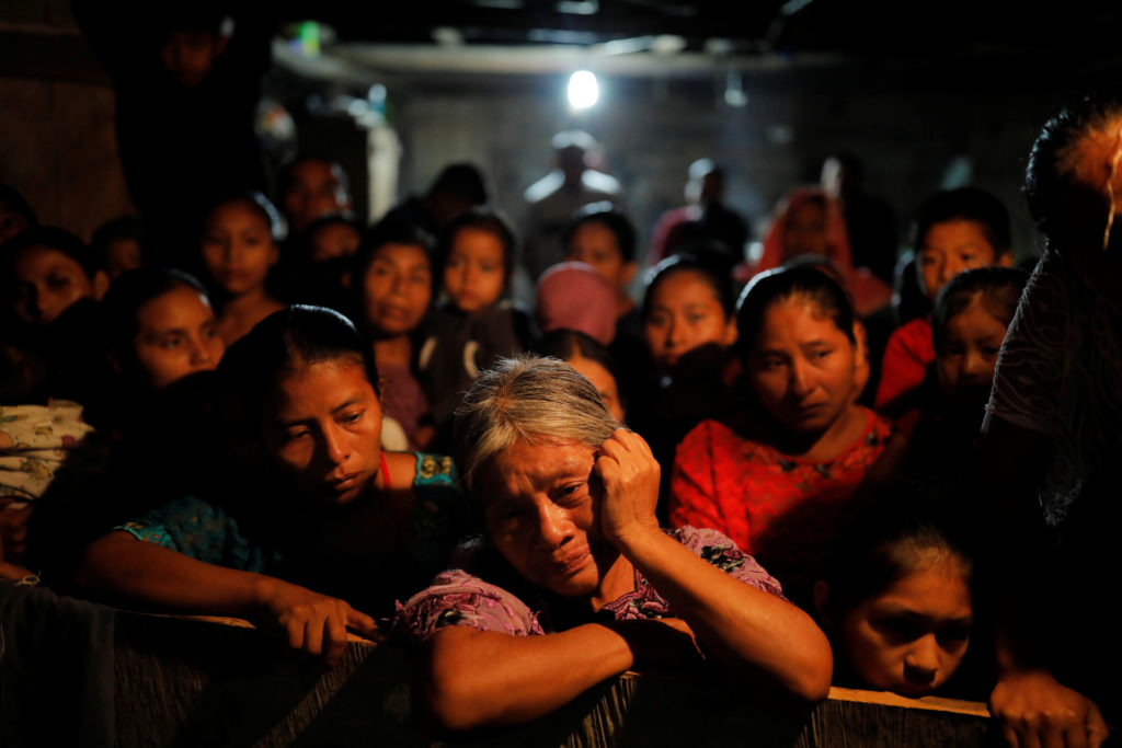 Elvira Choc, grandmother of Jakelin Caal, a 7-year-old girl who handed herself in to U.S. border agents earlier this month and died after developing a high fever while in the custody of U.S. Customs and Border Protection, reacts during a service at her home village of San Antonio Secortez, in Raxruha, Guatemala December 24, 2018. Photo by REUTERS/Carlos Barria