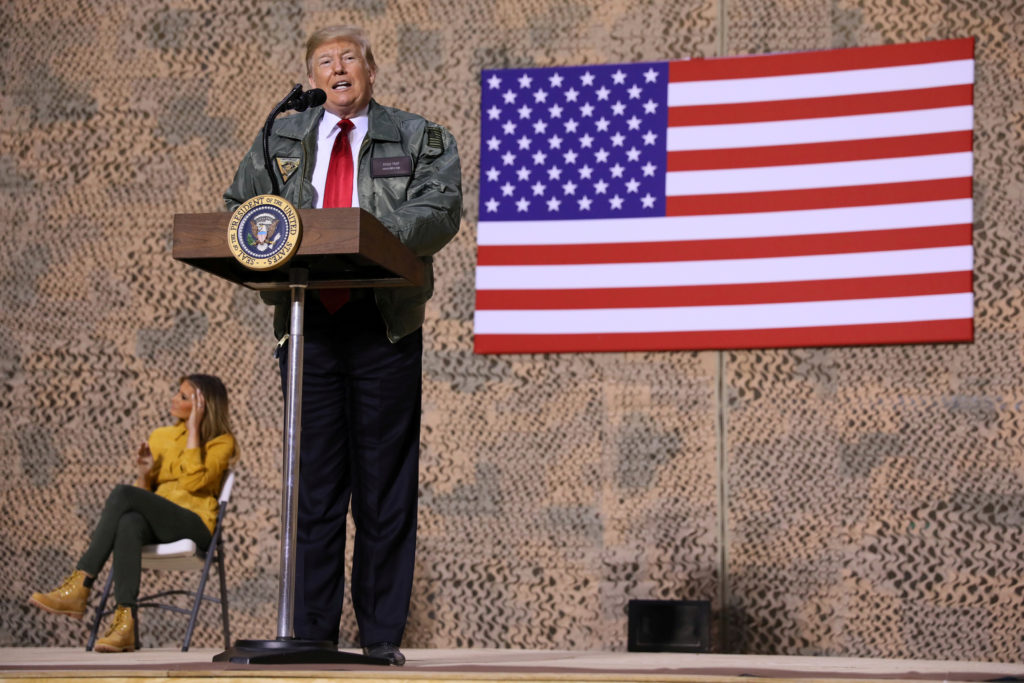 U.S. President Donald Trump delivers remarks to U.S. troops in an unannounced visit to Al Asad Air Base, Iraq December 26, 2018. REUTERS/Jonathan Ernst TPX IMAGES OF THE DAY - RC12FEF000E0