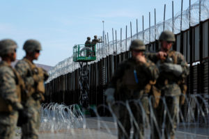 U.S. Marines deploy concertina wire at the U.S. Mexico border in preparation for the arrival of a caravan of migrants at the San Ysidro border crossing in San Diego, California. Photo by Mike Blake/Reuters