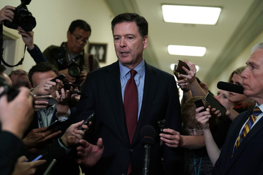Former FBI Director James Comey speaks to the media after giving a private deposition to the House Judiciary and House Government and Oversight committees on Capitol Hill in Washington, U.S., December 7, 2018. Photo by Joshua Roberts/Reuters
