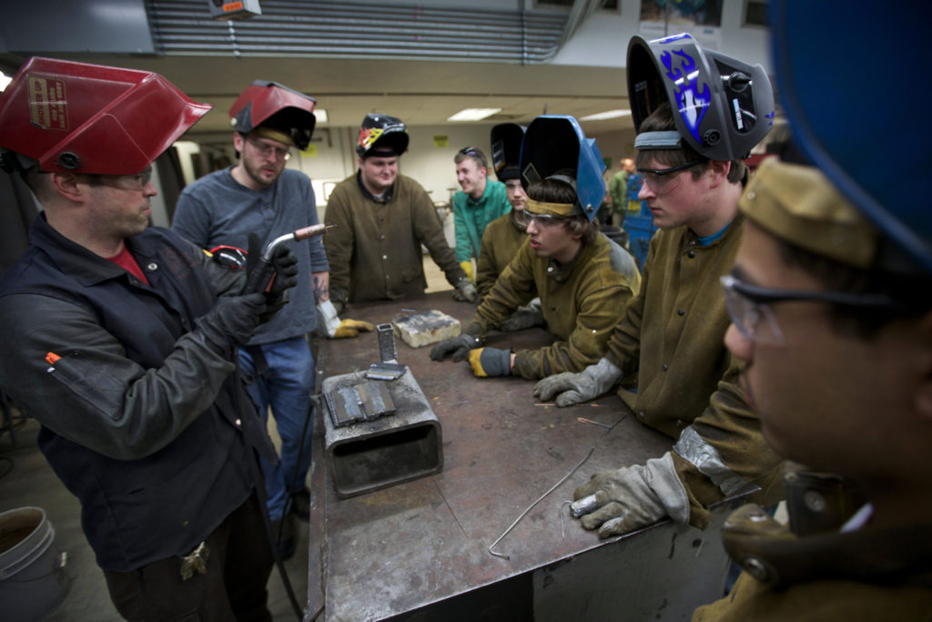 An instructor at Harper College in Palatine, Illinois,  shows students a welding technique. Career and technical education has seen a resurgence in the last decade after declining in the 1980s. Photo by John Gress/Reuters