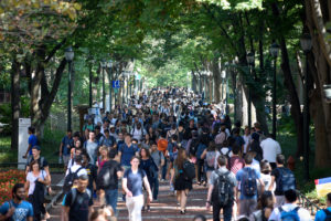 Students walk between classes on the Locust Walk on the campus of the University of Pennsylvania in Philadelphia. Photo by Charles Mostoller/Reuters