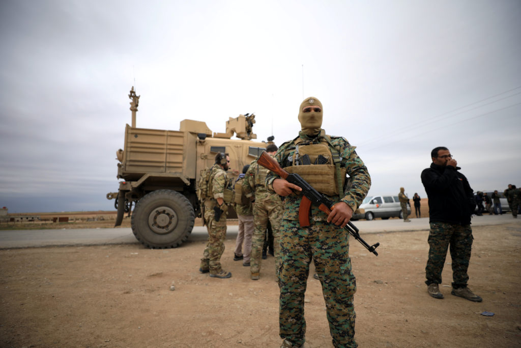 Syrian Democratic Forces and U.S. troops are seen during a patrol near Turkish border in Hasakah, Syria November 4, 2018. ...