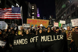 People take part in a protest to protect the investigation led by Special Counsel Robert Mueller, in New York City, U.S., November 8, 2018. REUTERS/Jeenah Moon