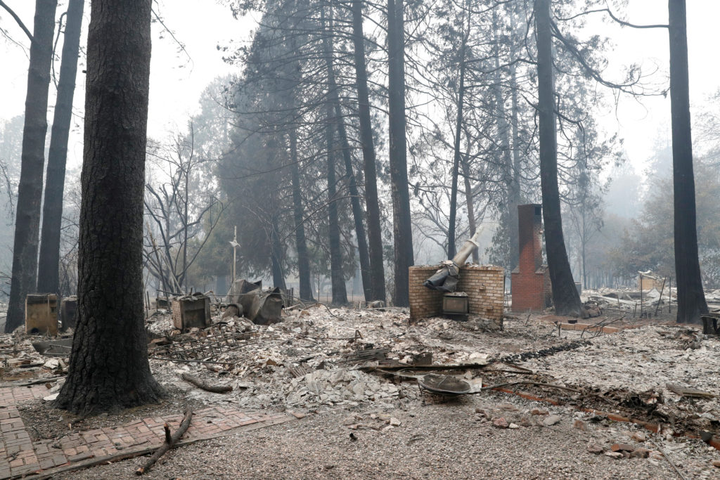 A house destroyed by the Camp Fire is seen in Paradise, California. Insurance claims have already topped $9 billion. Photo by Terray Sylvester/Reuters