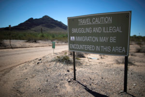 A sign warns of illegal immigrants crossing the U.S.-Mexico border in the desert near Lukeville, Arizona, U.S., September 11, 2018. Photo By Lucy Nicholson/Reuters