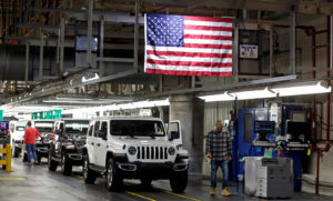 2019 Jeep Wranglers move to the Final 1 assembly line at the Chrysler Jeep Assembly plant in Toledo, Ohio. China is suspending a tariff hike on U.S. cars, trucks and auto parts for 90 days. Photo by Rebecca Cook/Reuters