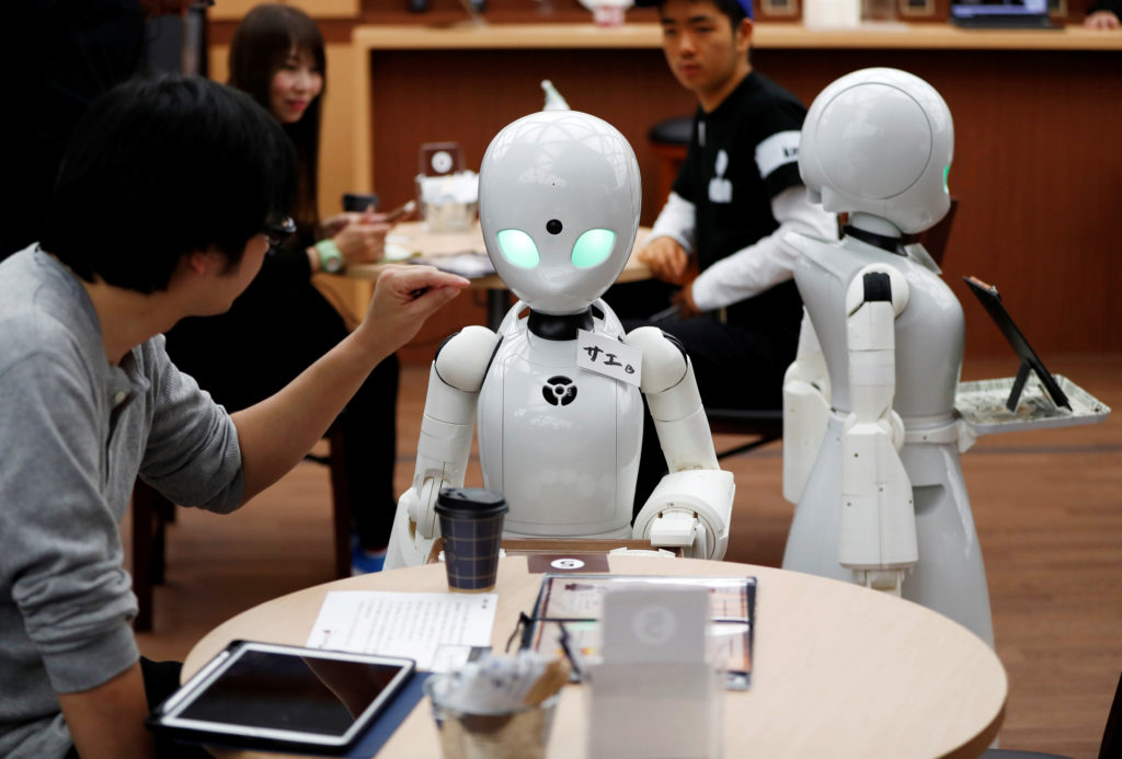 Remotely controlled robots OriHime-D, developed by Ory Lab Inc. to promote employment of disabled people, serve customers at a cafe in Tokyo, Japan. Japan, which has a declining population, is relying more on robots to make up for a worker shortage. Photo by Issei Kato/Reuters