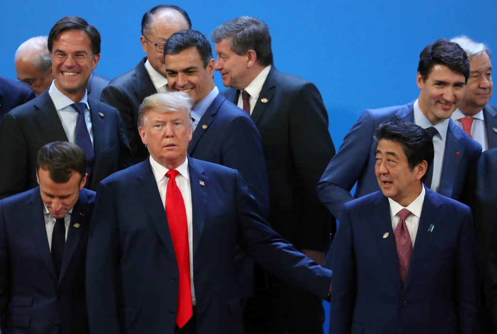 French President Emmanuel Macron, Dutch Prime Minister Mark Rutte, Spain's Prime Minister Pedro Sanchez, U.S. President Donald Trump, Canada's Prime Minister Justin Trudeau and Japanese Prime Minister Shinzo Abe are seen during the G20 summit in Buenos Aires, Argentina November 30, 2018. Photo by Marcos Brindicci/Reuters