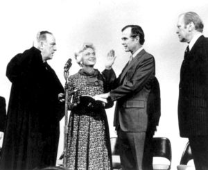 George H. W. Bush is sworn in as Director of CIA by Justice Potter Stewart (L) as President Gerald Ford (R) looks on, in this January 10, 1976 handout photo obtained by Reuters November 30, 2012. George Bush Presidential Library and Museum/Handout via Reuters