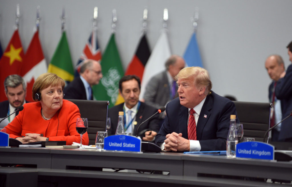 German Chancellor Angela Merkel and U.S. President Donald Trump attend the plenary session at the G20 leaders summit in Bu...