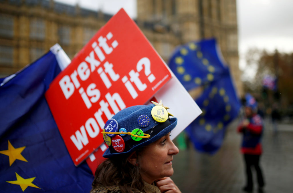 Anti-Brexit demonstrators protest outside the Houses of Parliament in London, Britain. Photo by Henry Nicholls/Reuters