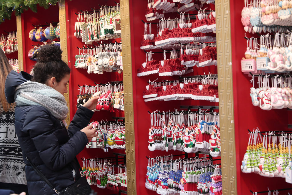 A woman shops for holiday ornaments at the Bryant Park Winter Village in New York, U.S., December 3, 2018. REUTERS/Shannon Stapleton