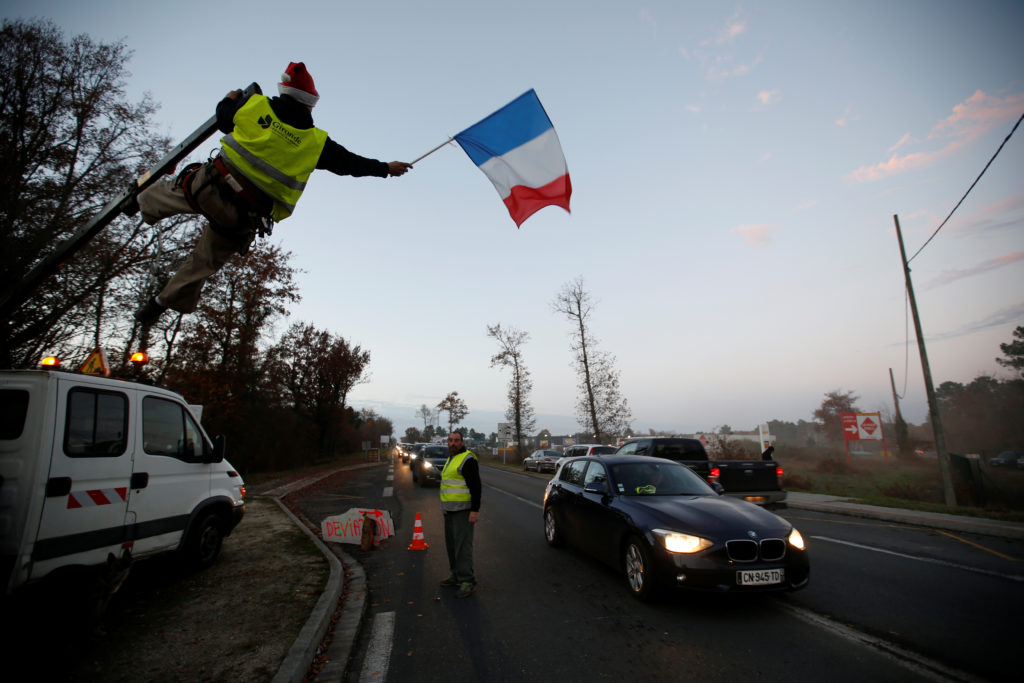 Protesters wearing yellow vests, the symbol of a French drivers' protest against higher diesel fuel prices, occupy a roundabout in Cissac-Medoc, France.    Photo by Regis Duvignau/Reuters