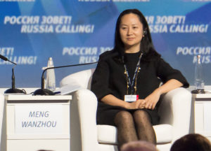 "Meng Wanzhou, the chief financial officer of the Chinese technology giant Huawei, attends a session of the VTB Capital Investment Forum ""Russia Calling!"" in Moscow. Wanzhou was arrested in Canada and faces possible extradition to the U.S. Photo by Alexander Bibik/Reuters"