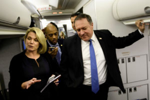 Spokesperson Heather Nauert (L) speaks as U.S. Secretary of State Mike Pompeo dialogues with reporters in his plane while flying from Panama to Mexico in October. Photo by Brendan Smialowski/Pool via Reuters