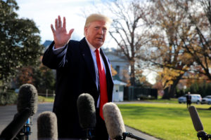 President Donald Trump waves to the press as he prepares to depart the South Lawn at the White House in Washington, D.C. Photo by Jim Young/Reuters