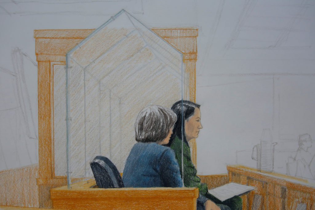 Huawei CFO Meng Wanzhou, who was arrested on an extradition warrant, appears at her B.C. Supreme Court bail hearing along with a translator, in a drawing in Vancouver, British Columbia, Canada December 7, 2018. Photo by Jane Wolsak/Reuters