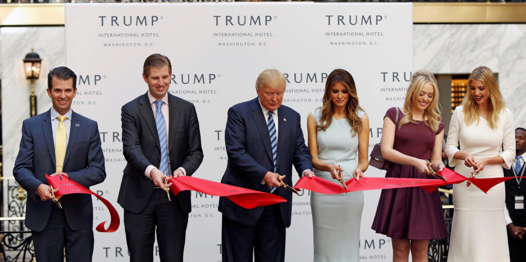 (L-R) Donald Trump Jr., Eric Trump, Republican U.S. presidential nominee Donald Trump, Melania Trump, Tiffany Trump and Ivanka Trump attend an official ribbon cutting ceremony at the new Trump International Hotel in Washington U.S., October 26, 2016. REUTERS/Gary Cameron TPX IMAGES OF THE DAY - D1BEUJFNJEAB