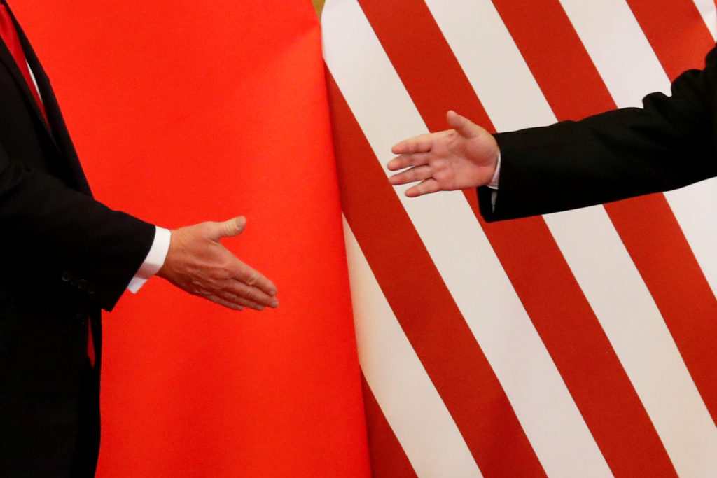 U.S. President Donald Trump and China's President Xi Jinping shake hands after making joint statements at the Great Hall o...