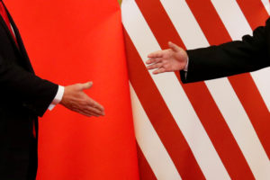 """U.S. President Donald Trump and China's President Xi Jinping shake hands after making joint statements at the Great Hall of the People in Beijing, China, November 9, 2017. Damir Sagolj: """"It's one of those """"how to make a better or at least different shot when two presidents shake hands several times a day, several days in row"""". If I'm not mistaken in calculation, presidents Xi Jinping of China and Donald Trump of the U.S. shook their hands at least six times in events I covered during Trump's recent visit to China. I would imagine there were some more handshakes I haven't seen but other photographers did. And they all look similar - two big men, smiling and heartily greeting each other until everyone gets their shot. But then there is always something that can make it special - in this case the background made of U.S. and Chinese flags. They shook hands twice in front of it, and the first time it didn't work for me. The second time I positioned myself lower and centrally, and used the longest lens I have to capture only hands reaching for a handshake."""" Photo by Damir Sagolj/Reuters"""