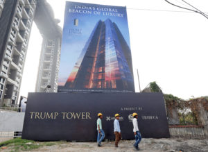 Construction workers walk past a billboard of Trump Tower, a luxury apartment building, at a construction site in Kolkata, India, February 19, 2018. Picture taken February 19, 2018. Photo by Rupak De Chowdhuri/Reuters