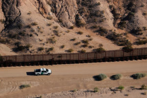 A U.S. border patrol truck drives along thew border fence between Mexico and Sunland Park, New Mexico. Officials say U.S. Boder Patrol agents found the girl who suffered seizures was found near Lordsburg, New Mexico. Photo by Mike Blake/Reuters