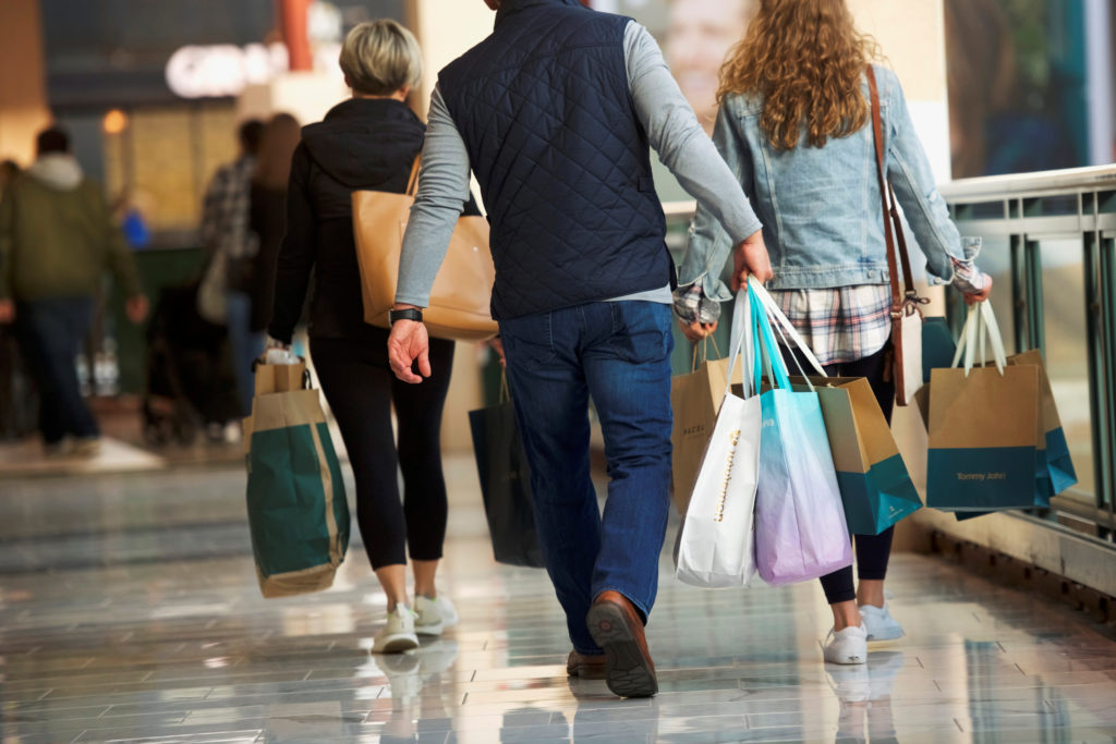 Shoppers carry bags of purchased merchandise at the United States' largest retail shopping space, in King of Prussia, Penn...